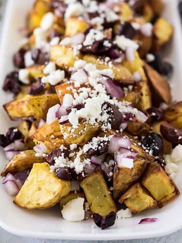 Oven roasted potatoes topped with feta cheese.