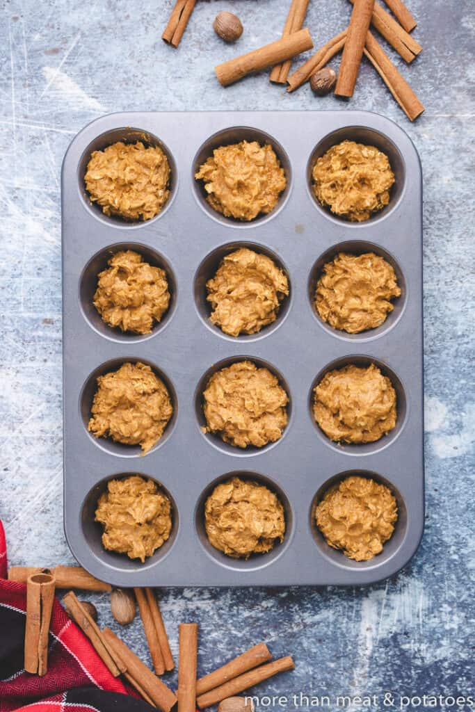 The pumpkin muffin batter transferred to a muffin tin.