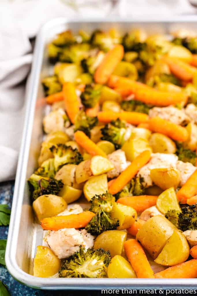Roasted meat and vegetables on a sheet pan.