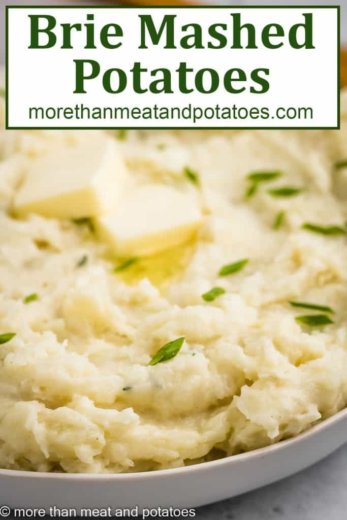 A close-up view of the brie mashed potatoes with butter.
