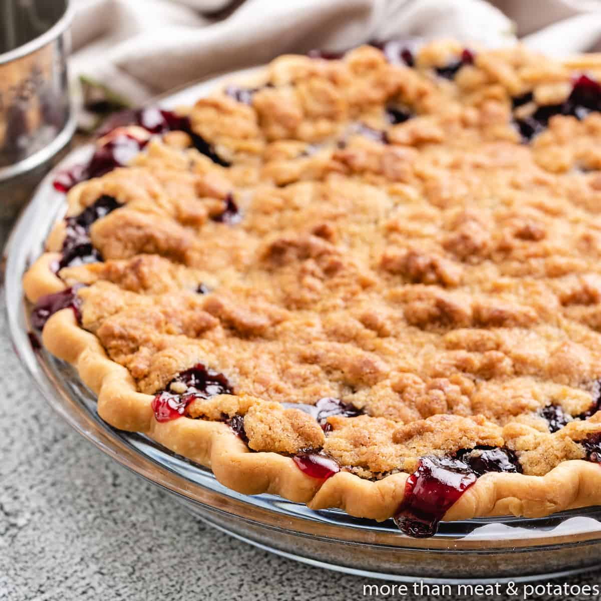 The fresh baked cherry pie with crumb topping cooling.