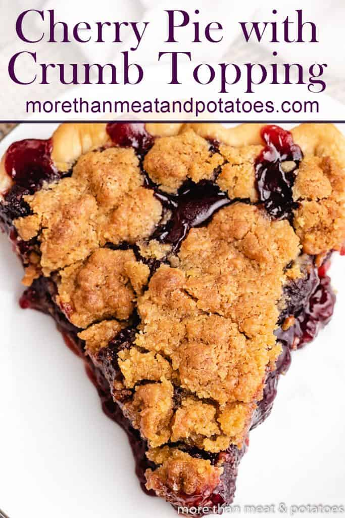 An aerial view of a slice of the cherry pie with crumb topping.