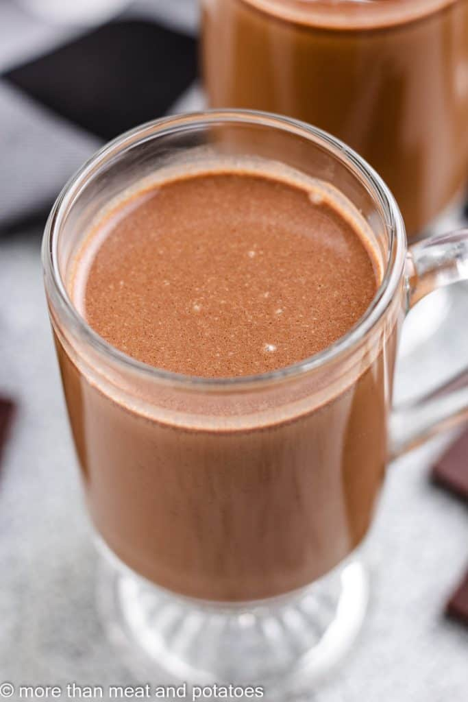 An up-close view of chocolate coffee in a mug.