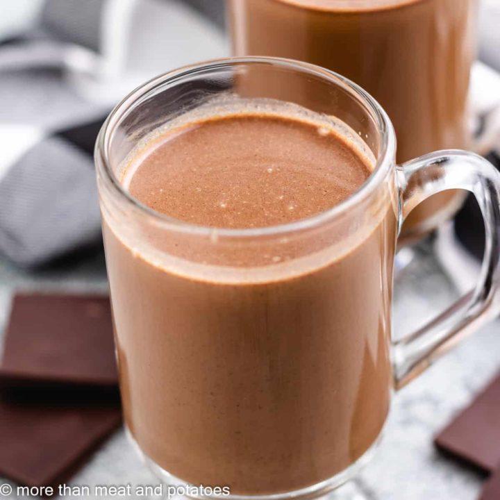 A mug filled with rich, dark chocolate coffee.
