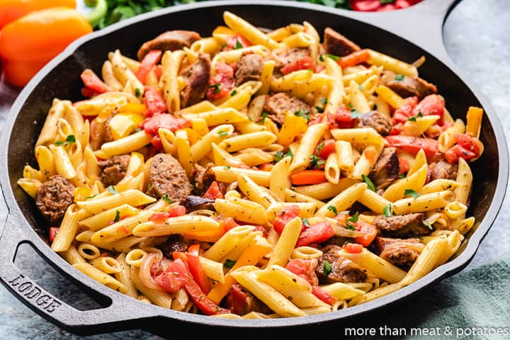 The sausage and peppers pasta in a skillet.