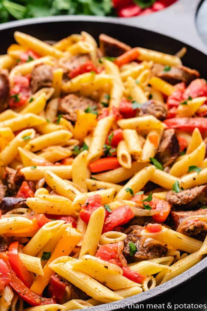 The meat and veggies pasta sitting in the pan.