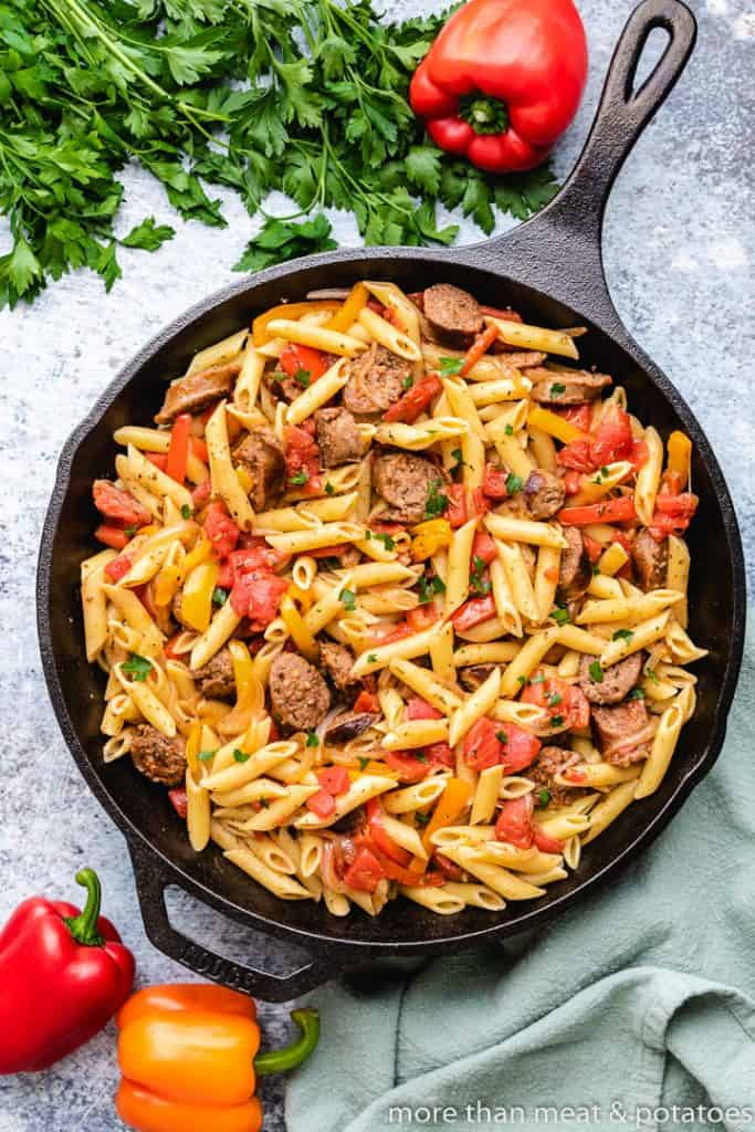 The cooked pasta noodles added to the skillet.