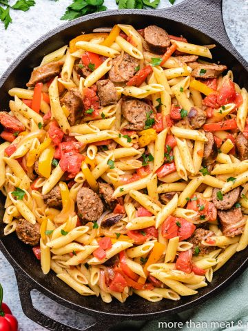 A top-down view of the sausage and peppers pasta.