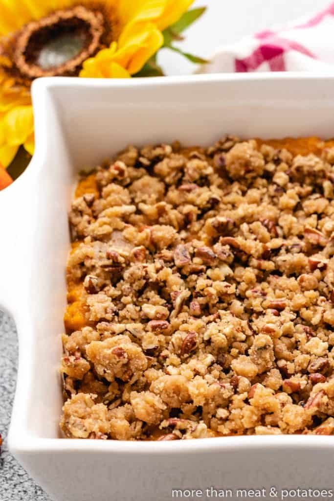 A close-up view of the pecan topping on the casserole.