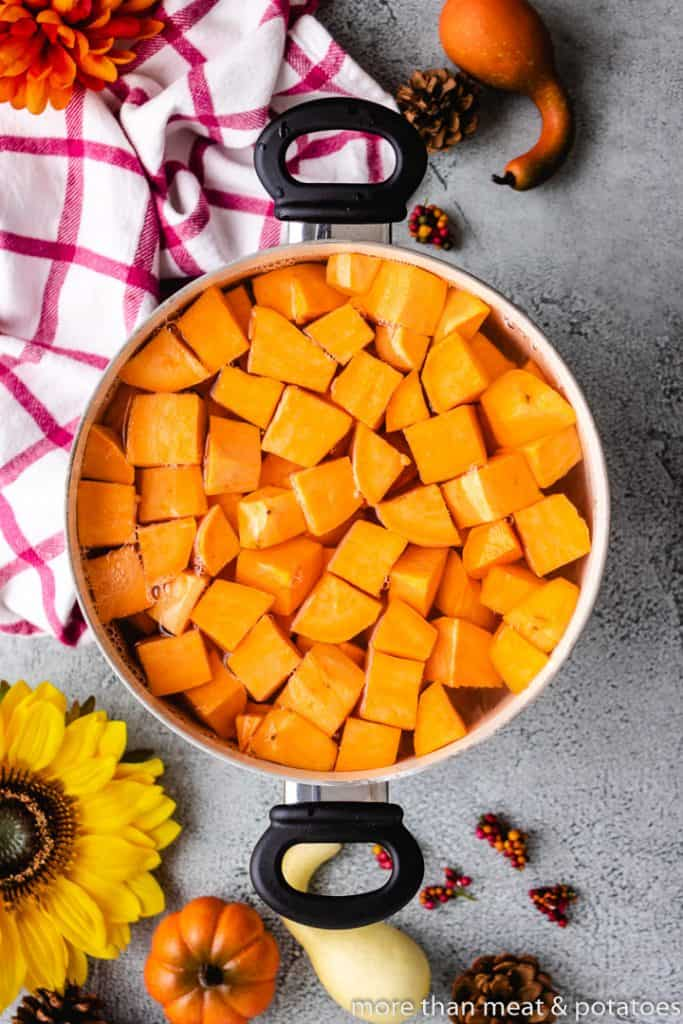 Cubed sweet potatoes in a pot of water.