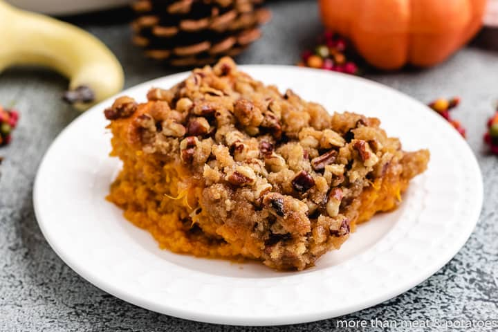 A slice of the sweet potato casserole on a plate.