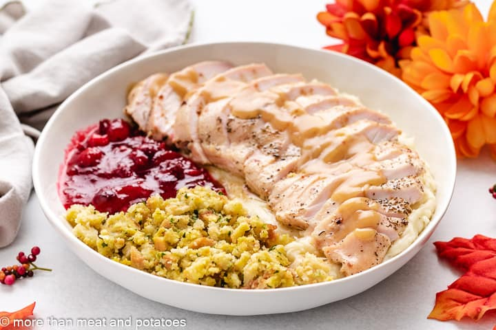 Brined and cooked turkey breast with gravy and sides.
