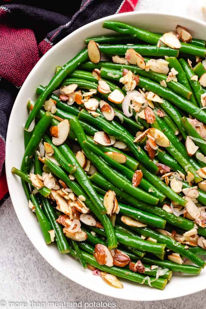 A top-down shot of the string beans in a bowl.