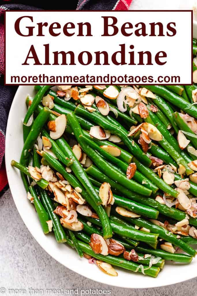 A top-down view of green beans almondine in a bowl.