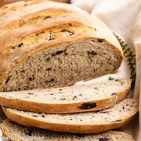 Fresh baked and sliced Kalamata olive bread.