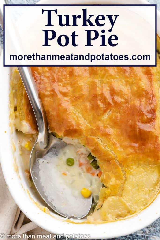 A serving of turkey pot pie with puff pastry removed from the dish.
