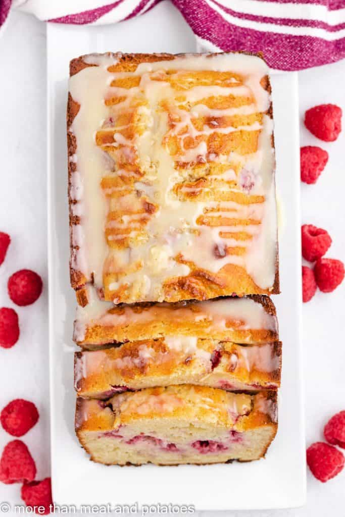 Top down view of sliced white chocolate raspberry bread.