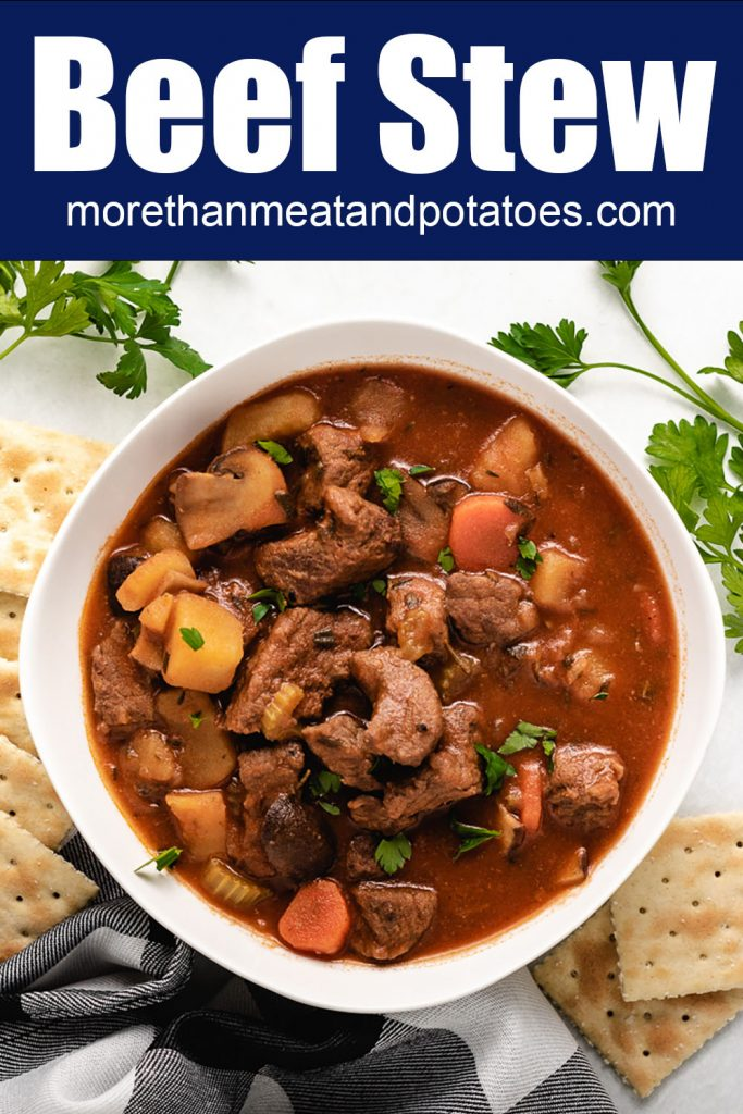 A top-down view of the homemade beef stew served with saltines.