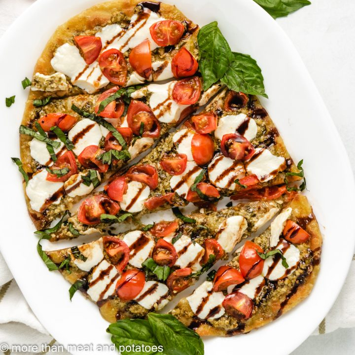 Top down of Caprese Flatbread on a plate.