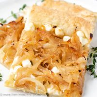 Slices of onion tart on a plate.