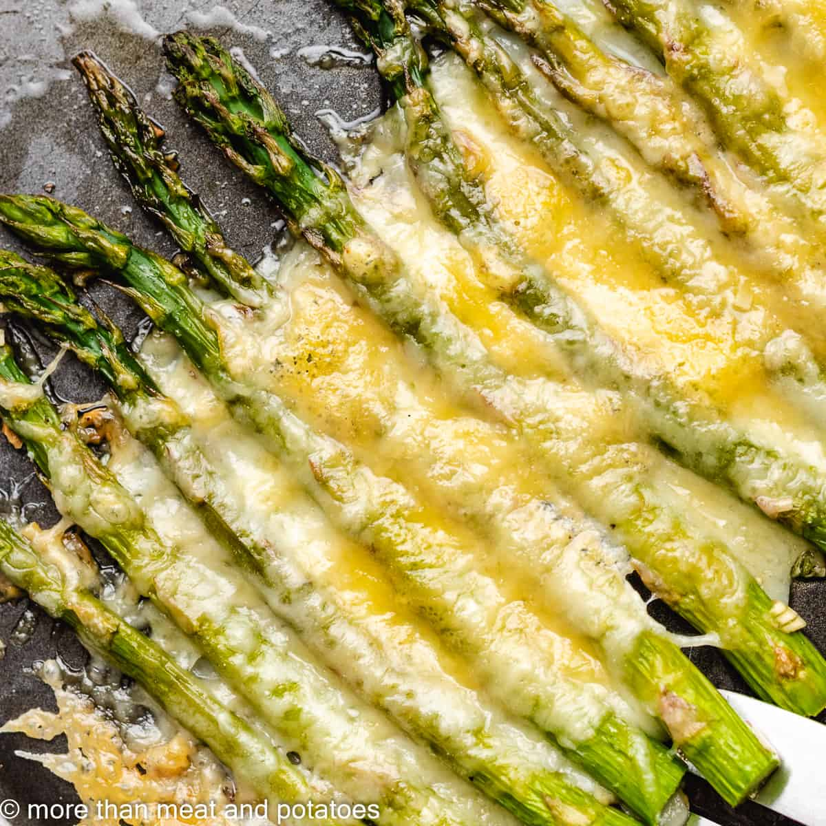 A close-up view of the cheesy garlic roasted asparagus.