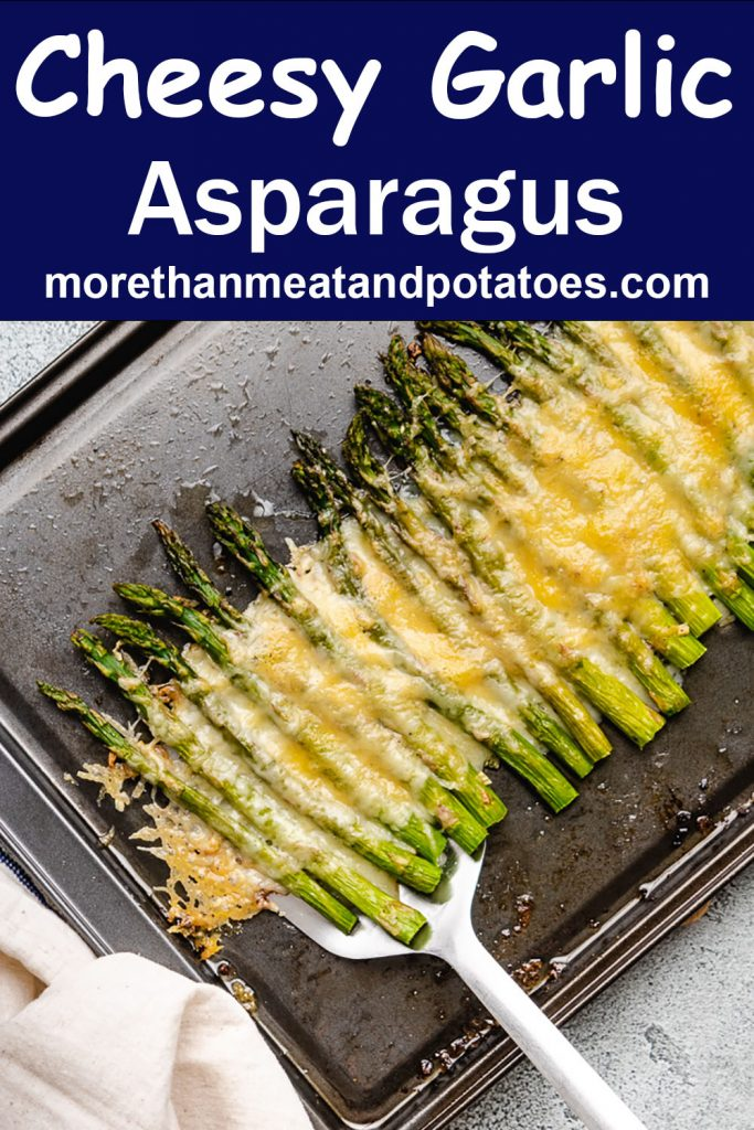 An aerial view of the cheesy garlic roasted asparagus on a sheet pan.