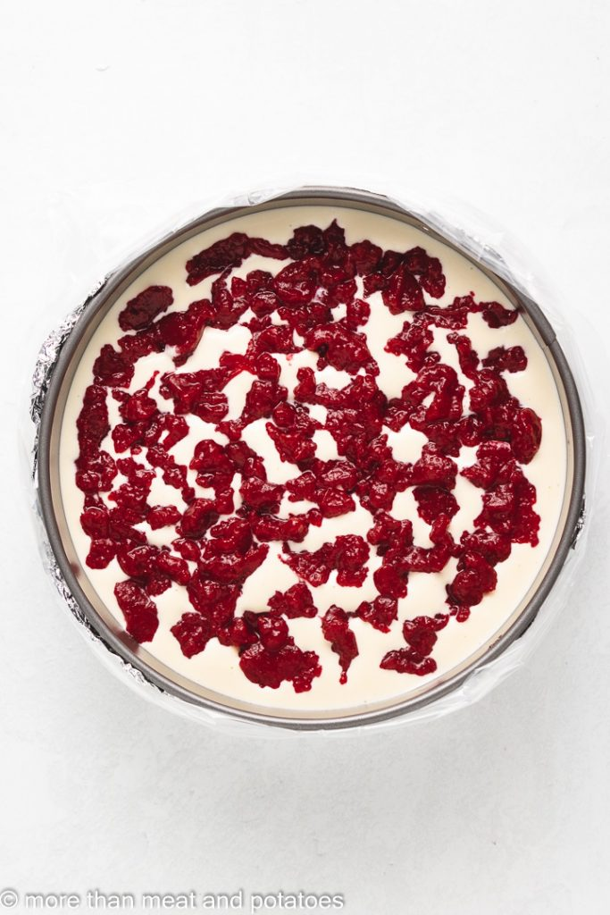 Top down view of cranberry filling in a cheesecake.