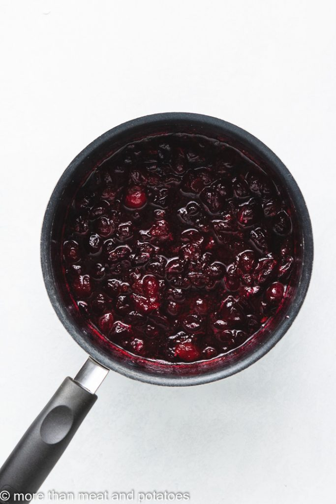 """Top down view of cranberry """"jelly"""" in a pan."""