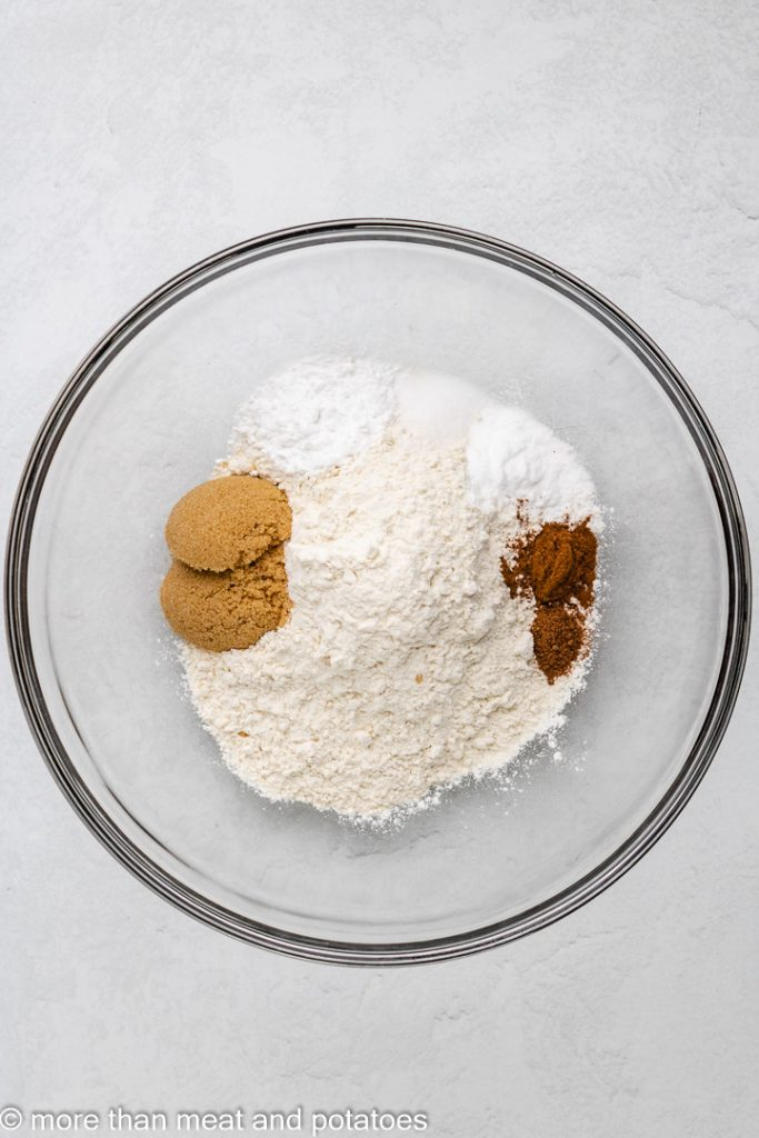 Cinnamon, flour, and other ingredients in a mixing bowl.