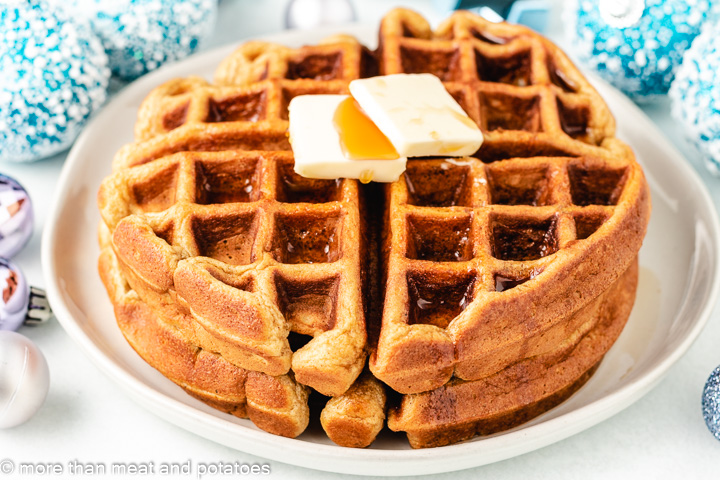 Eggnog waffles topped with butter and pure maple syrup.