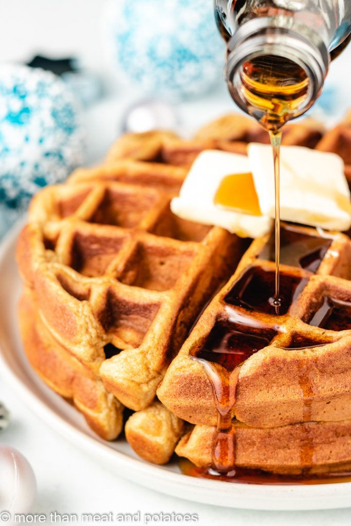 Pure maple syrup being drizzled over the waffles.