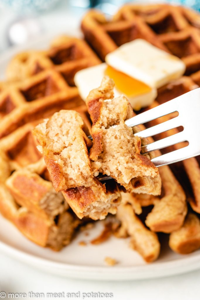 A bite of the waffles being removed with a fork.