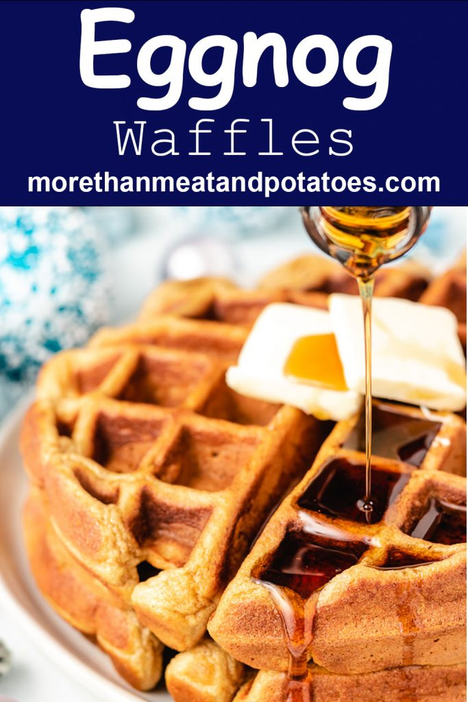 Pure maple syrup being poured over eggnog waffles.