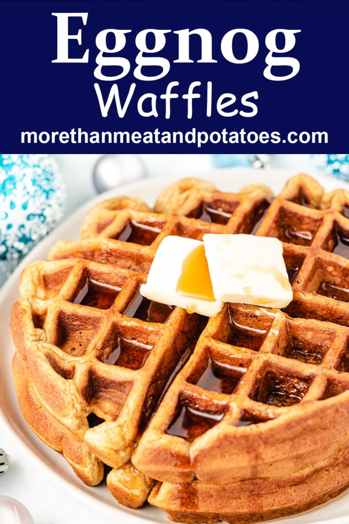 Homemade eggnog waffles with butter and syrup.