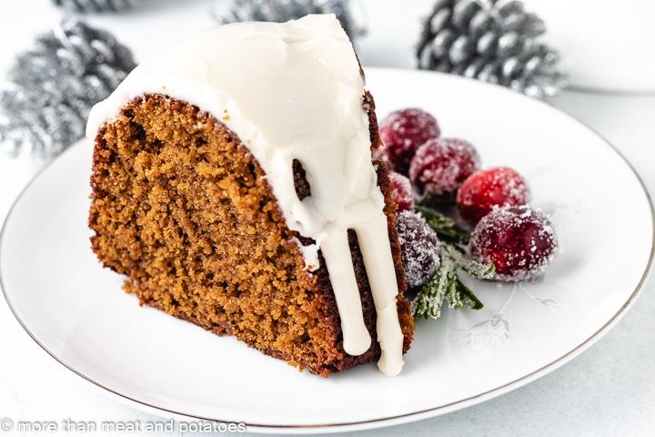 Slice of gingerbread bundt cake on a plate.