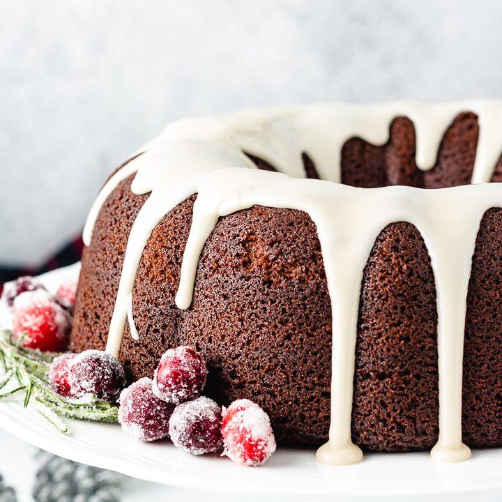 Bundt cake on a white cake stand.