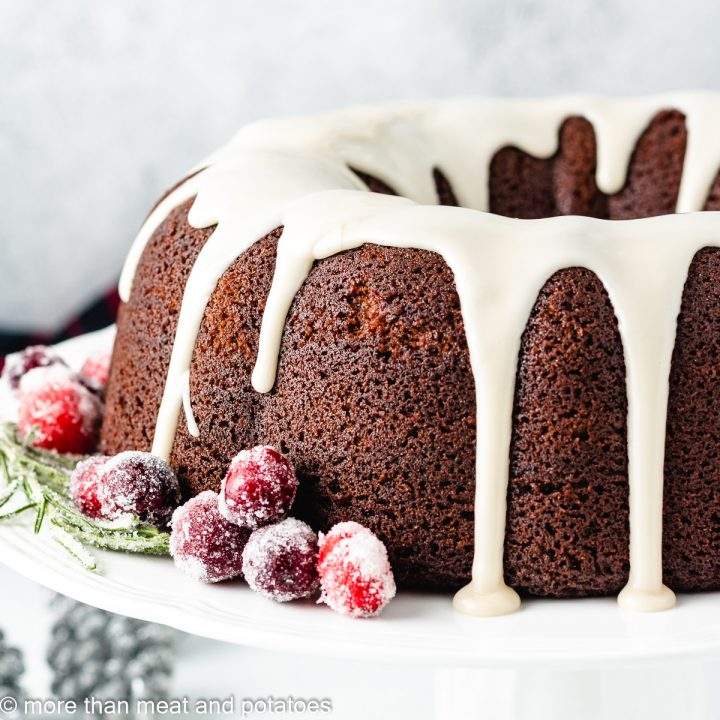 Cake with cranberries on a stand.