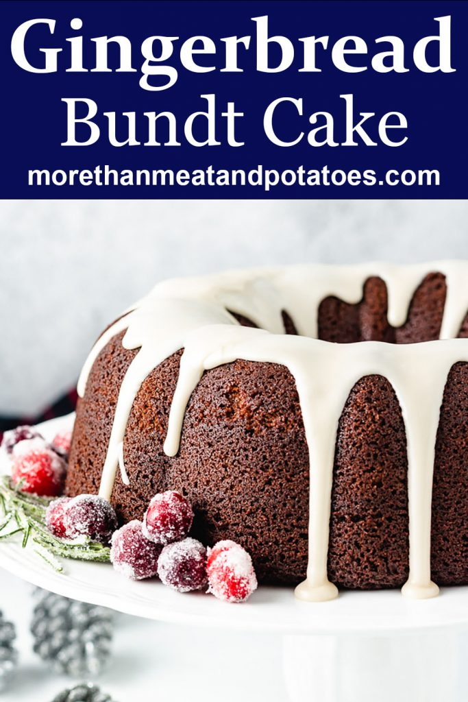 Gingerbread bundt cake on a white cake stand.