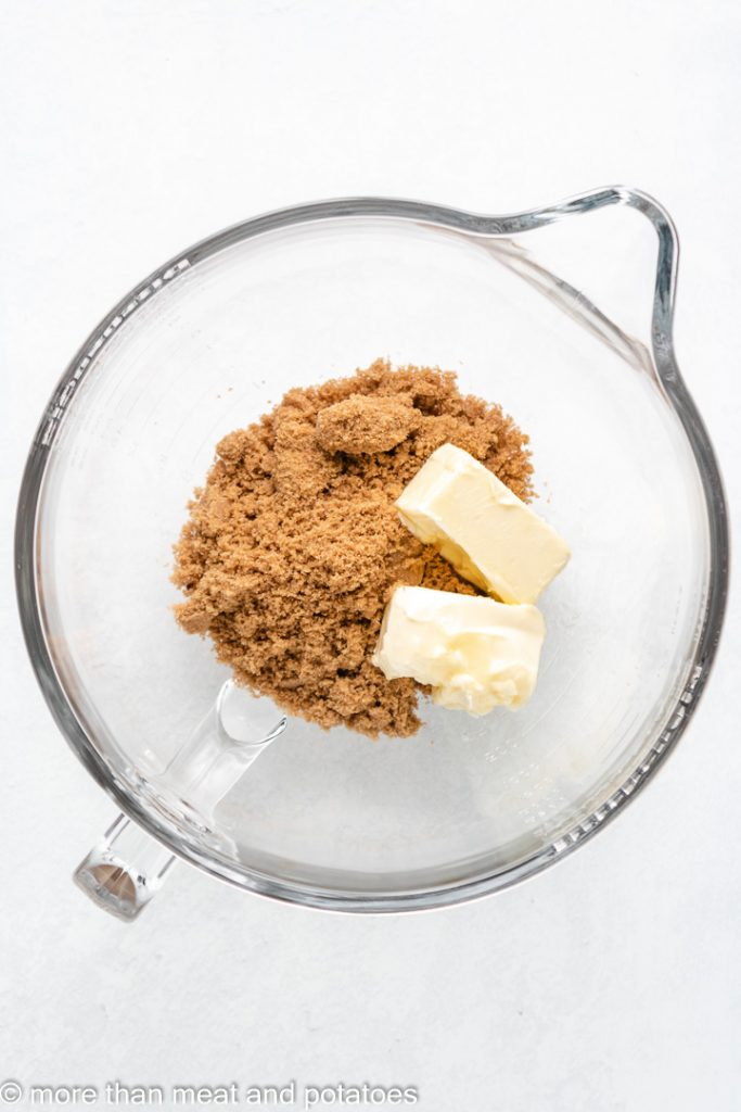 Brown sugar and butter in a stand mixing bowl.