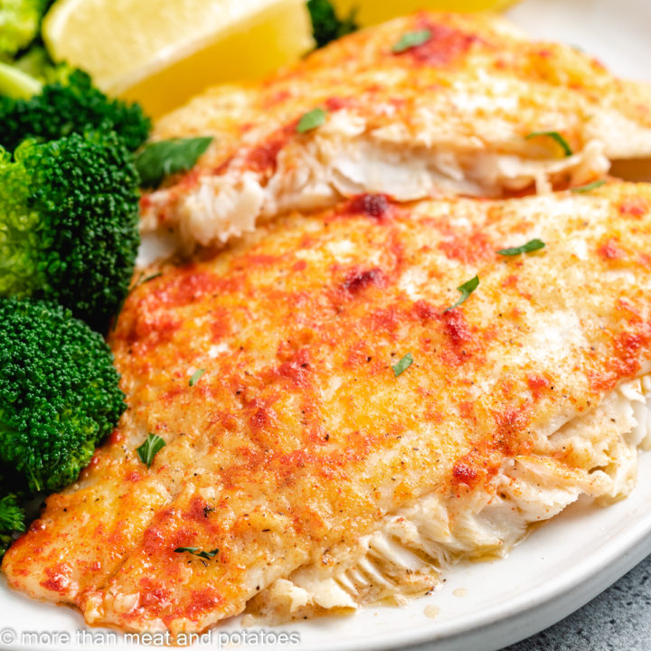 Baked flounder topped with smoked paprika and fresh parsley.
