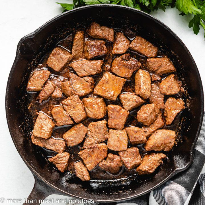 Cooked steak bites in Cajun butter sauce.