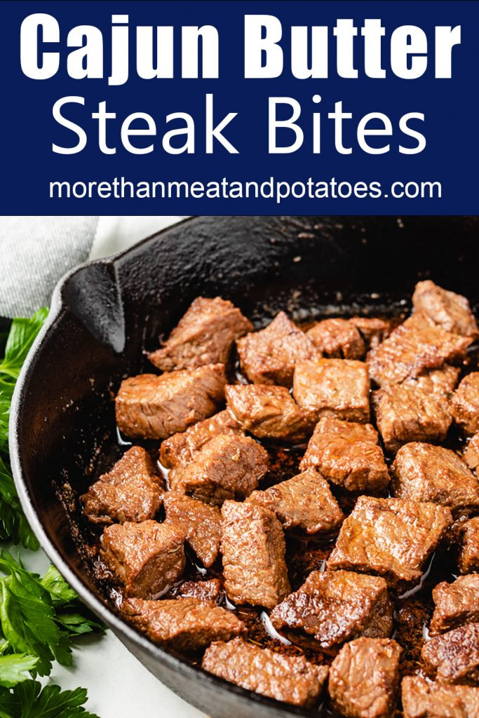 Close up view of steak bites in a skillet.