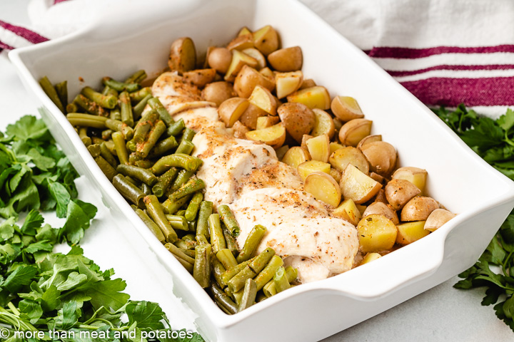 Chicken and green bean dinner in a pan.