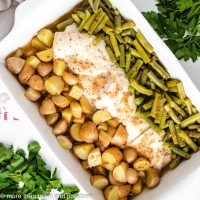 Baked chicken green beans and potatoes with seasoned butter.