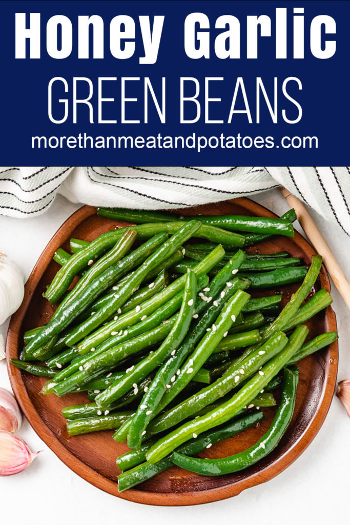 Green beans and sesame seeds on a plate.