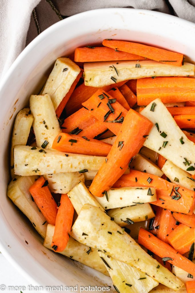 Top down view of roasted vegetables with fresh rosemary.