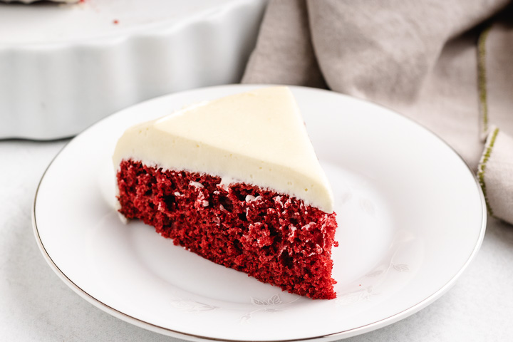 Red velvet cake on a white dish.