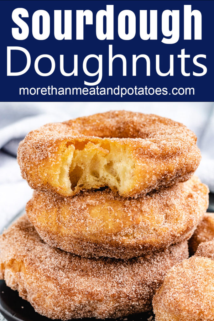 Stack of sourdough doughnuts with a a bite taken out.