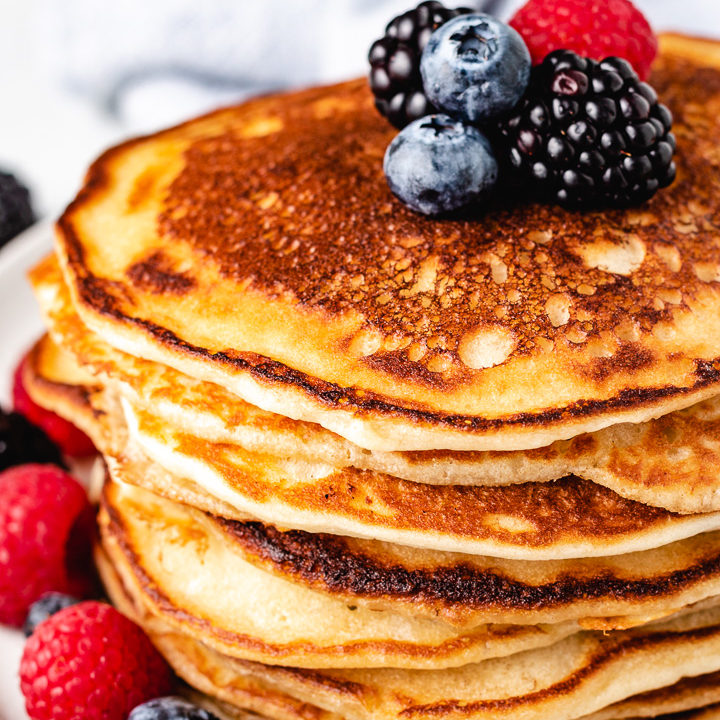 Stack of sourdough pancakes with blueberries.