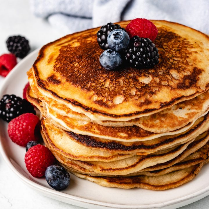 Sourdough Starter Pancakes topped with fresh fruit.